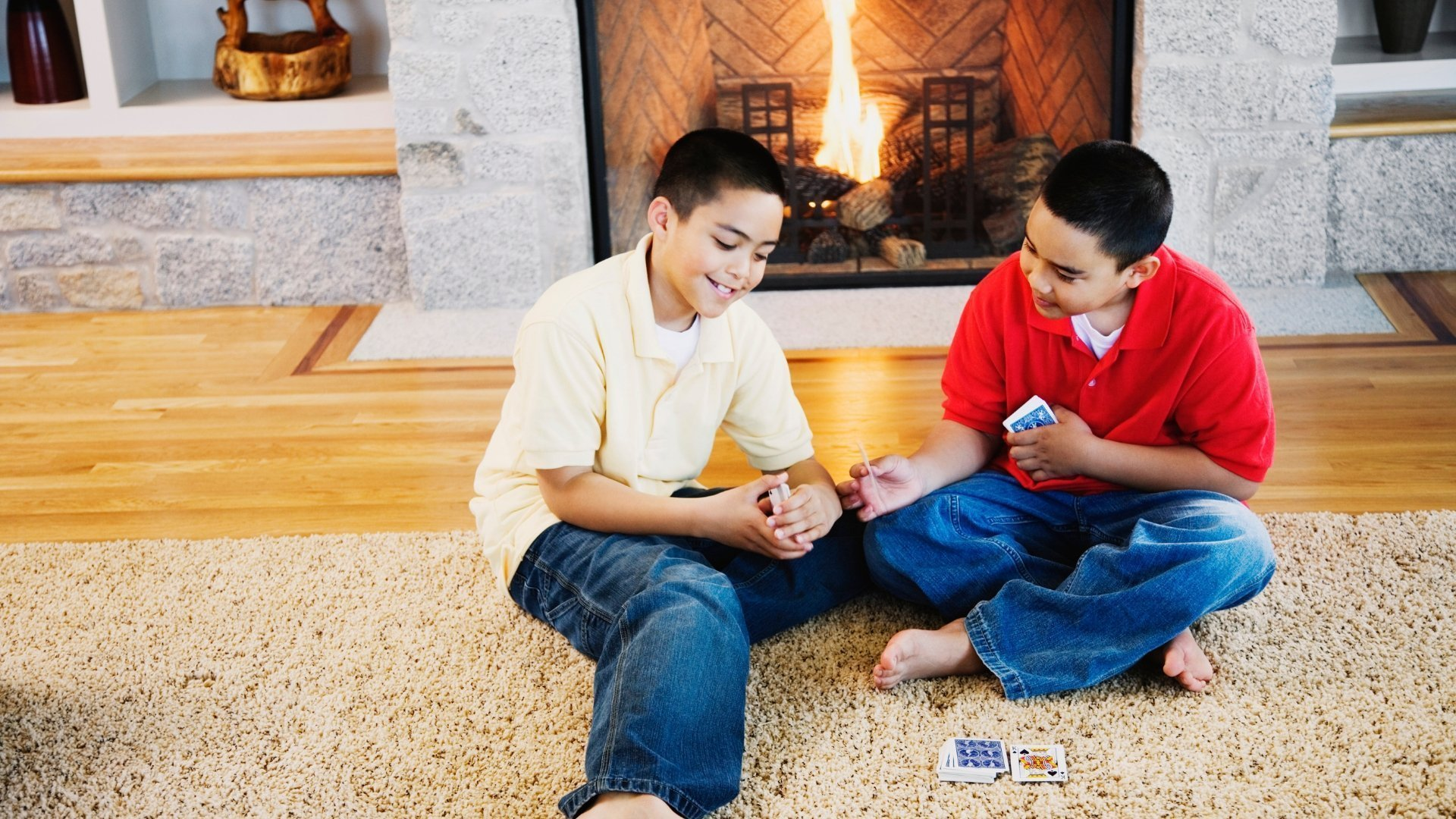 Boys Sitting in Front of Fire Playing Cards