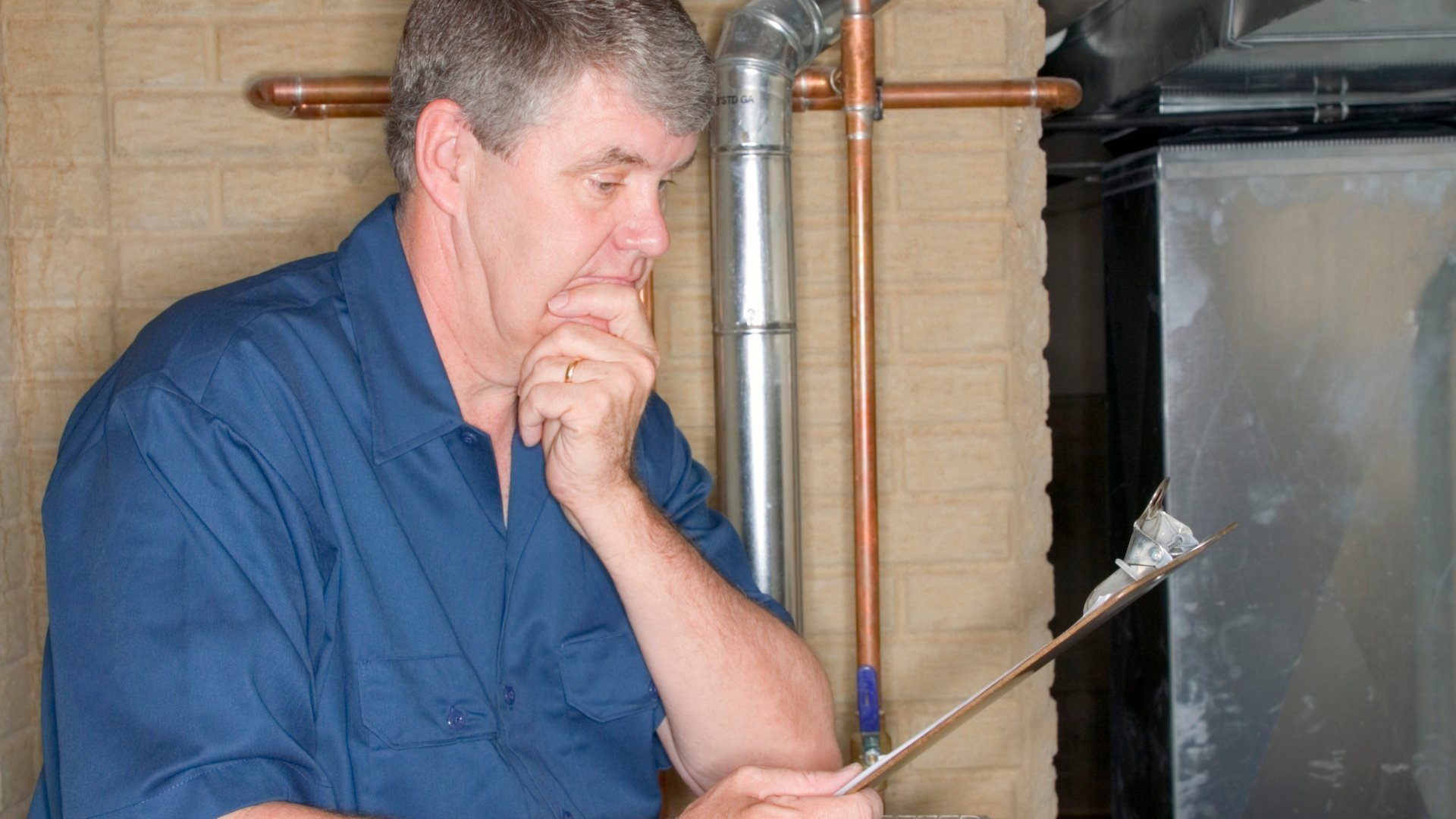 Technician with Clipboard Performing Home Assessment and Energy Audit