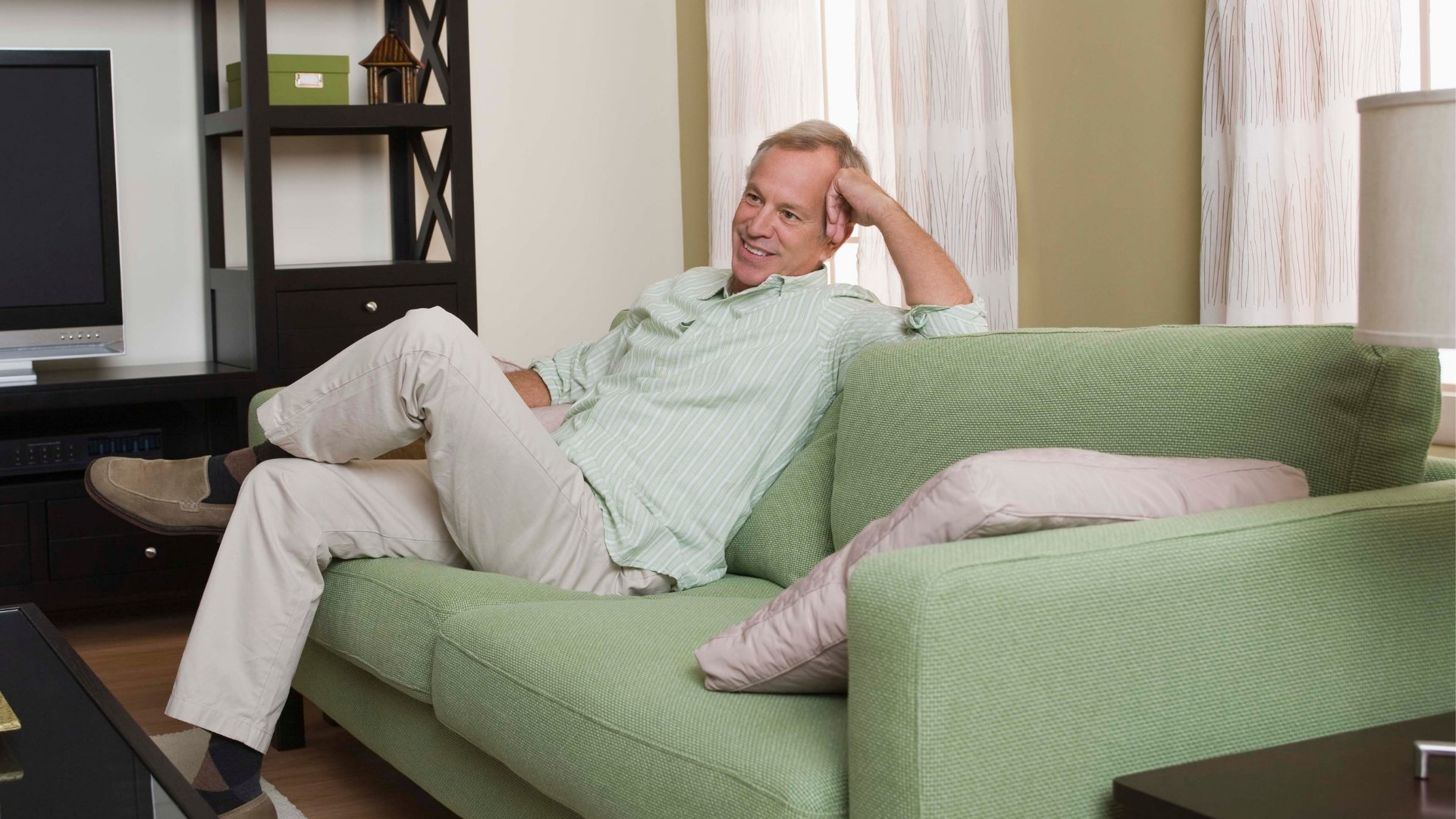 Man Sitting on Couch Wondering How the Air Moves Through His House