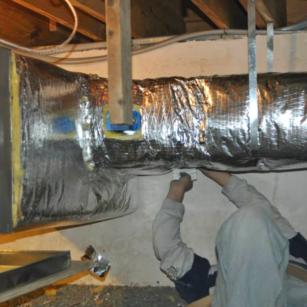 Technician Sealing Ductwork - Duct Sealing Page Gallery